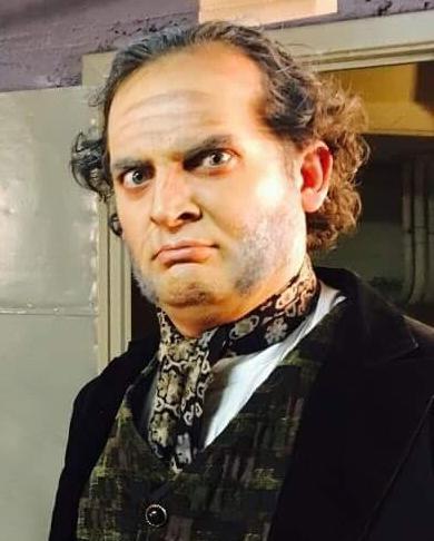 Dickens, portrayed by Travis Rhett Wilson